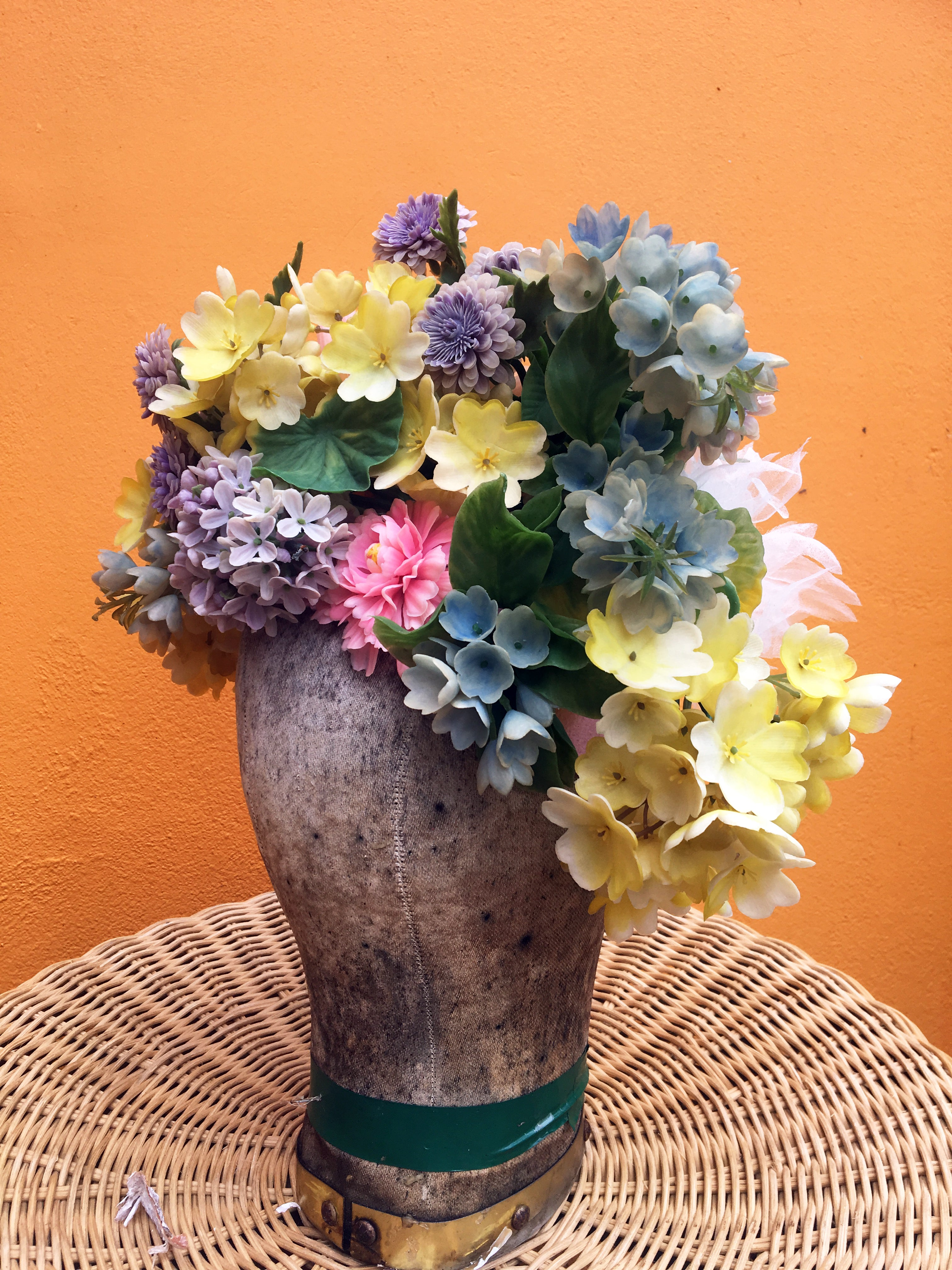 Vintage flowers in a floral Headdress in pastel shades