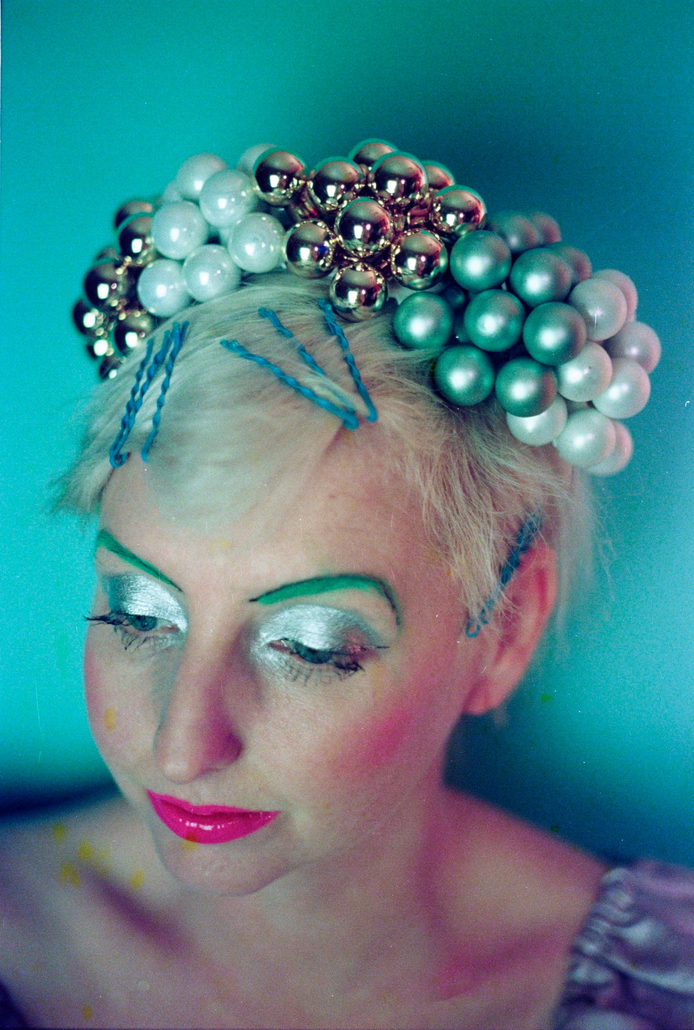 Metallic gold green and white bauble headdress