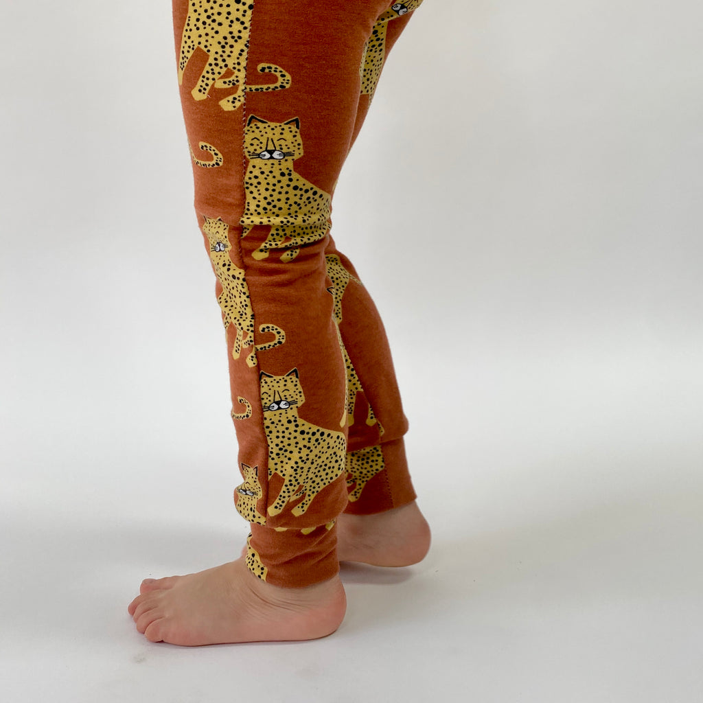 "Eddie & Bee organic cotton leggings in Rust ""Happy Leopards"" print."