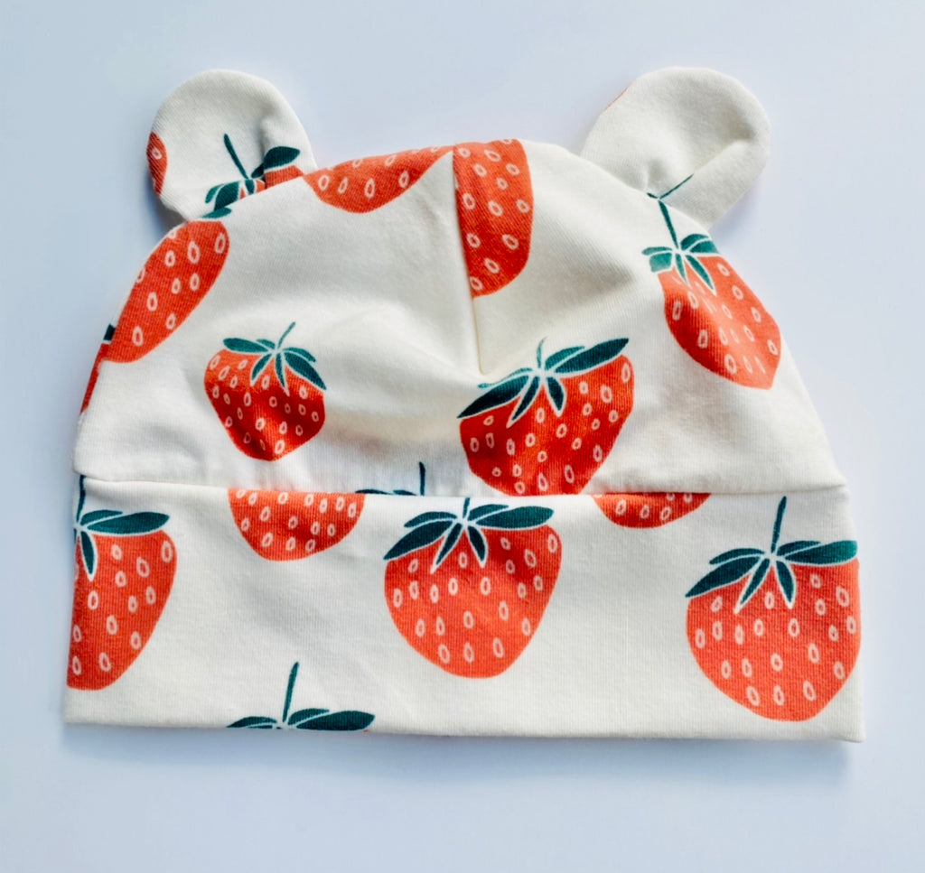 "Eddie & Bee organic cotton Baby hat with ears  in Cream "" Strawberry"" print."