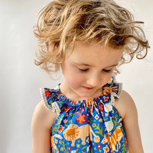 "Eddie & Bee Flutter sleeve romper in Royal Blue ""Animal Menagerie"" print organic cotton with cream pompom trim"