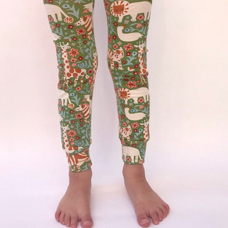 "Eddie & Bee organic cotton leggings in Moss ""Animal Menagerie"" print."