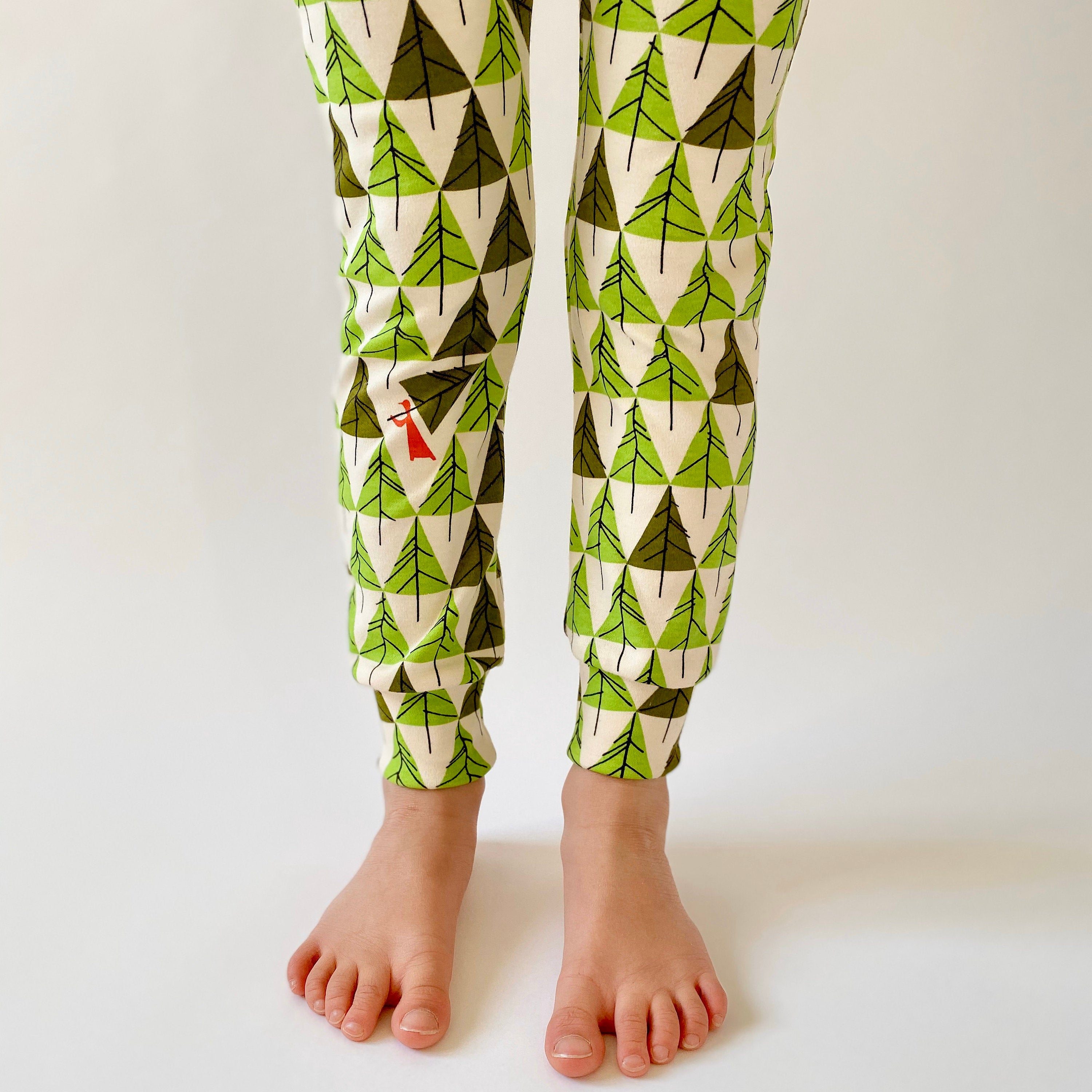 "Eddie & Bee limited edition Christmas organic cotton leggings in  ""Pick the perfect tree"" print."
