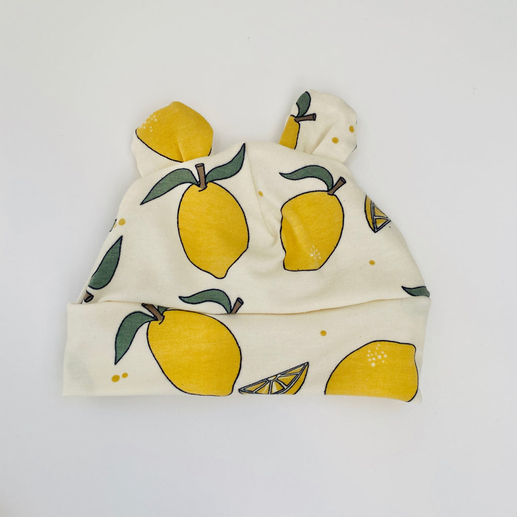 "Eddie & Bee organic cotton Baby hat with ears  in Cream "" Lemon Grove"" print."