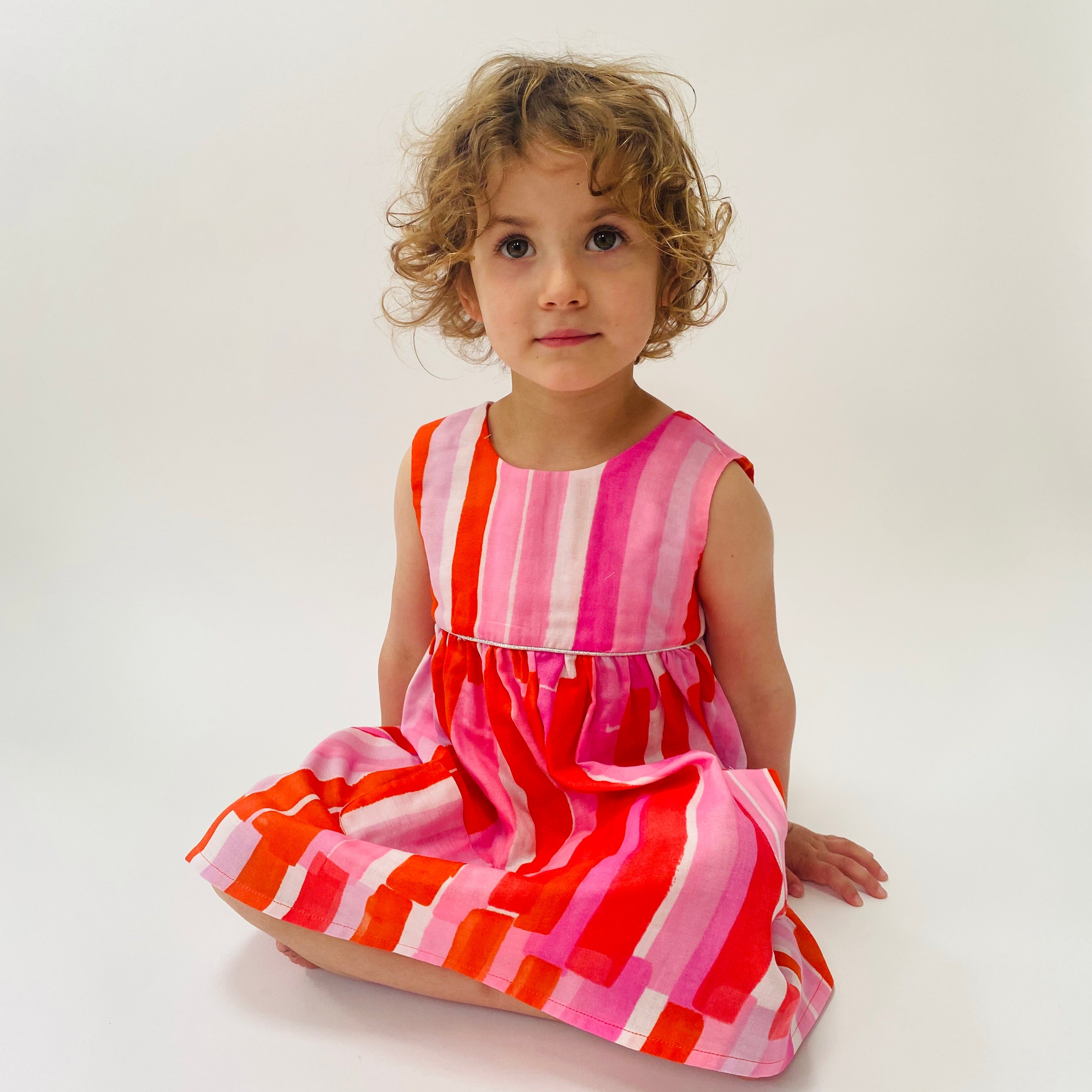 "Eddie & Bee ""Ida"" dress in Pink and red paint stripes printed super soft cotton double gauze with silver trim and POCKETS!"