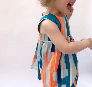 "Eddie & Bee ""Ida"" dress in Neon paint stripes printed super soft cotton double gauze with silver trim and POCKETS!"