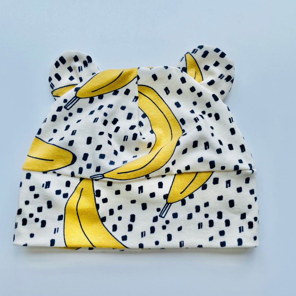 "Eddie & Bee organic cotton Baby hat with ears  in Cream "" Banana Pop!"" print."