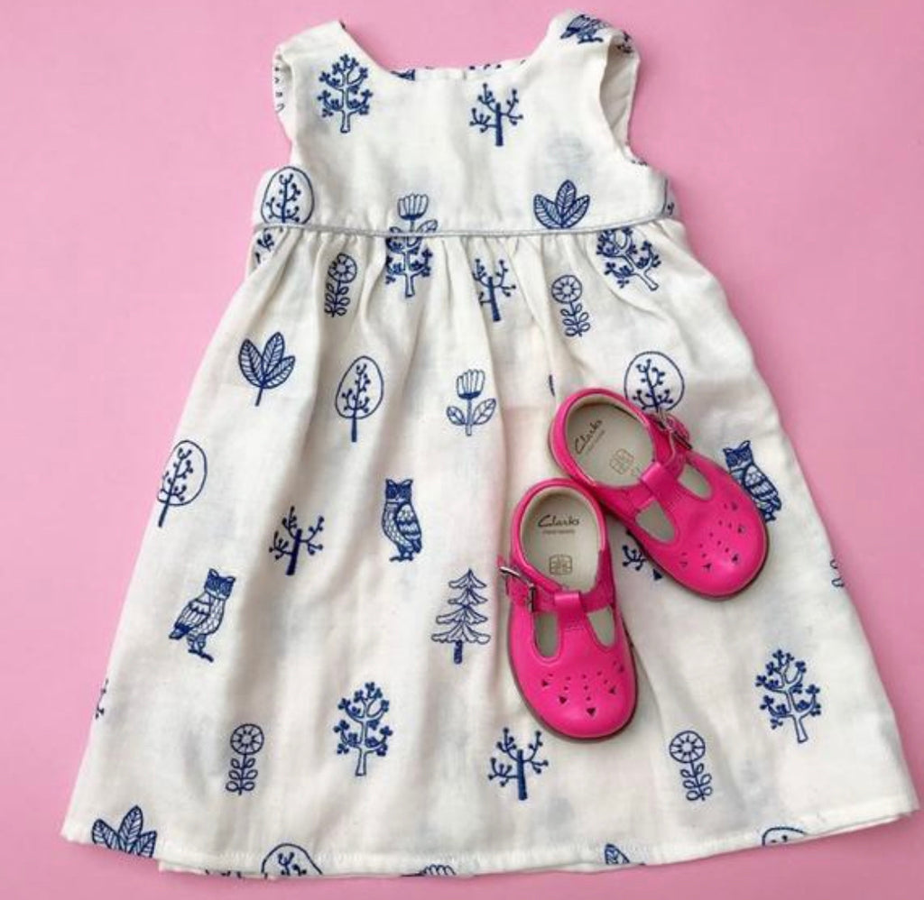 "Eddie & Bee embroidered ""Ida"" dress in cream and blue ""Owl in the woods"" print super soft cotton double gauze wirh silver trim."