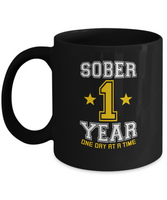 One Year Sober - AA Sobriety 1st Anniversary Black 11/15oz Mug - 12steptees
