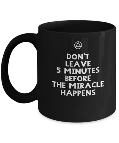 'Don't Leave 5 Minutes Before the Miracle Happens' - AA 12 Step Black Coffee Mug - 12steptees