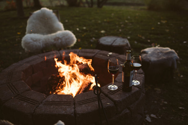 sheepskin on chair by fire pit