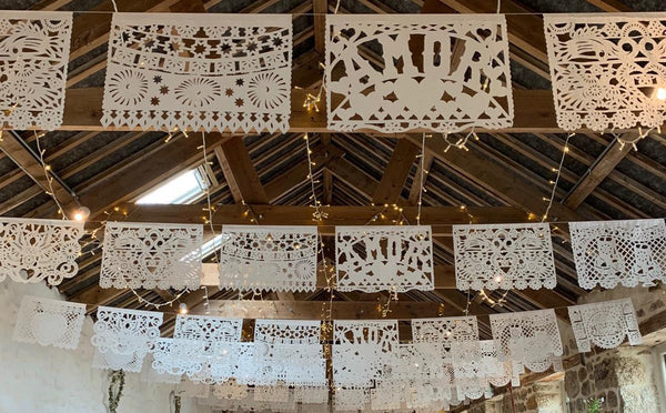 Papel picado hanging styles, hung straight across