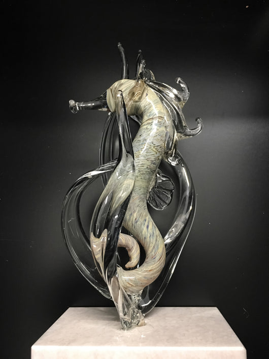 Glass Seahorse on white marble base