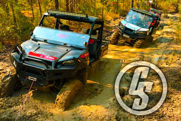Side by Sides wheeling through the mud and using a Custom Splice Synthetic Winch Rope and Aluminum Hawse Fairlead.