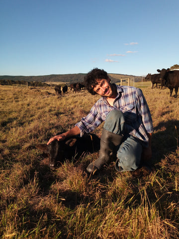 Alex in the paddock with a day old calf
