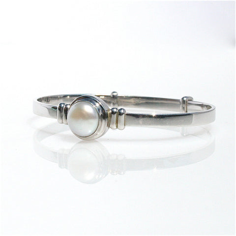 PEARL STRETCH BRACELET WITH STERLING SILVER GUARDIAN ANGEL CHARM