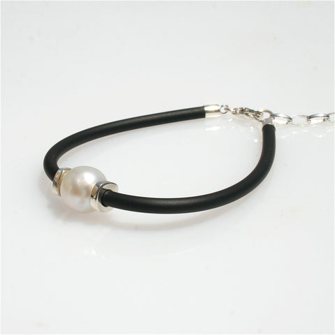 CROCODILE TOOTH PENDANT SET IN STERLING SILVER WITH BLACK COTTON NECKLACE: ADJUSTABLE IN LENGTH