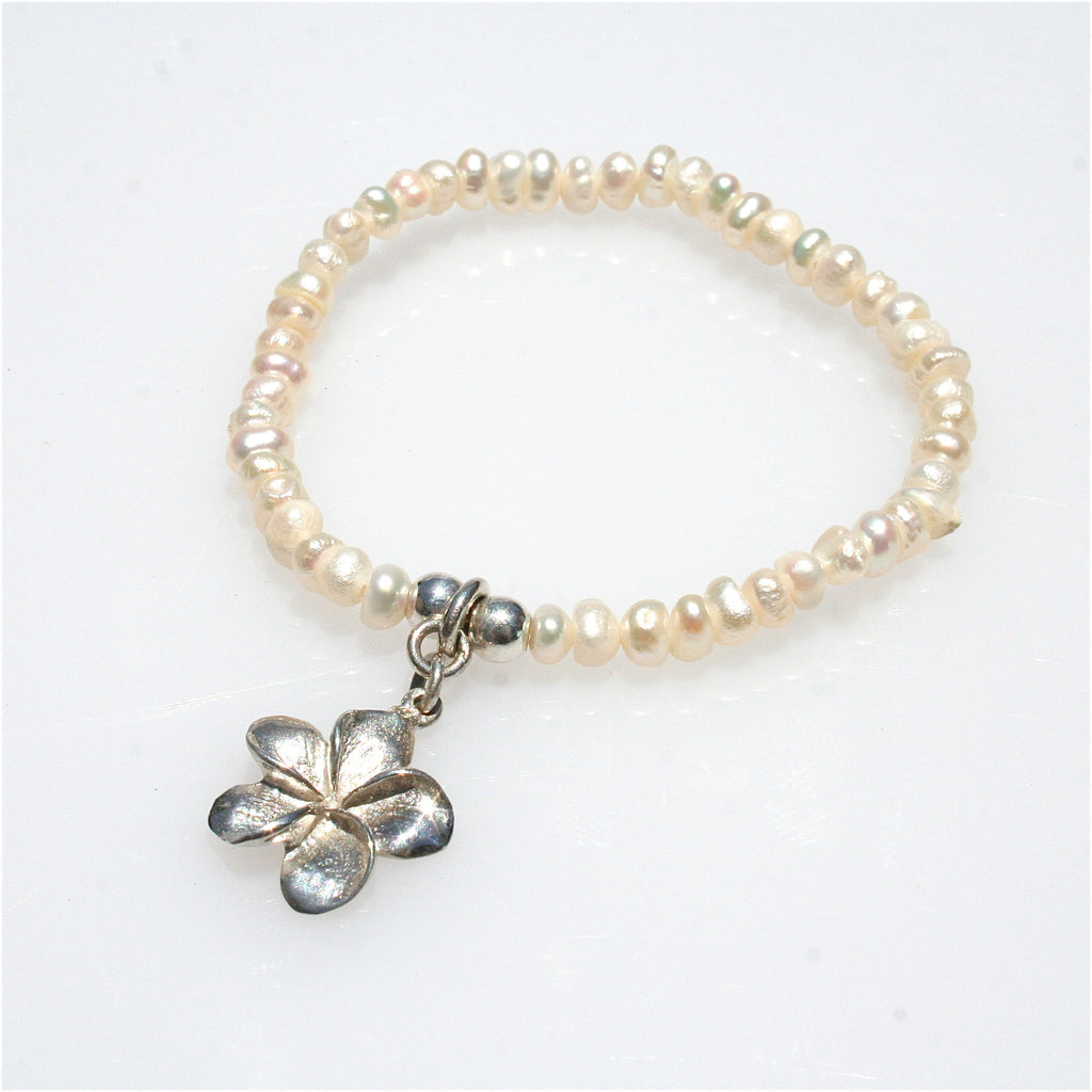 PEARL STRETCH BRACELET WITH STERLING SILVER FRANGIPANI CHARM