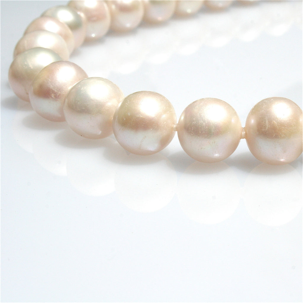 PEARL NECKLACE INDIVIDUALLY HAND KNOTTED ON SILK WITH STERLING SILVER CLASP