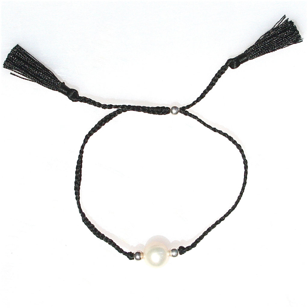 PEARL & BLACK COTTON TASSEL BRACELET