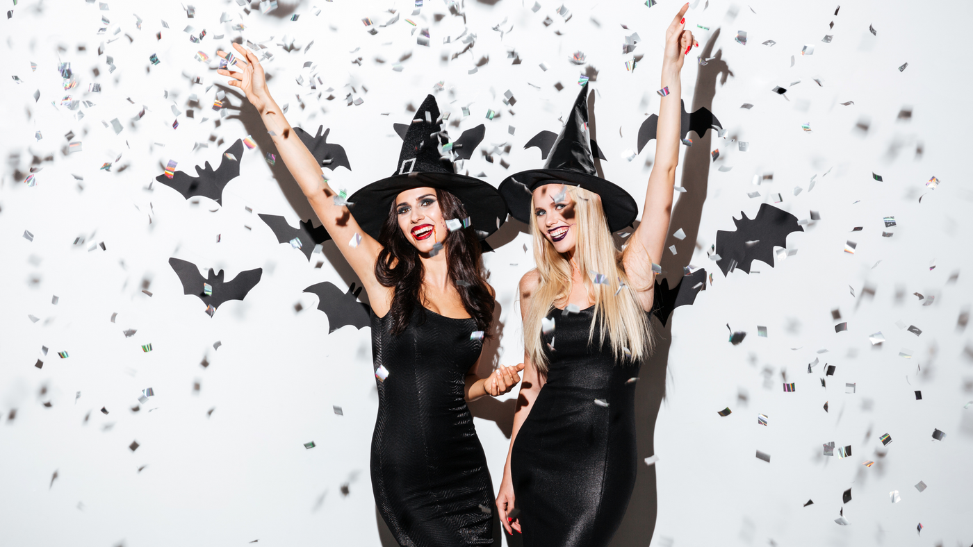 girls dressed as witches celebrating halloween