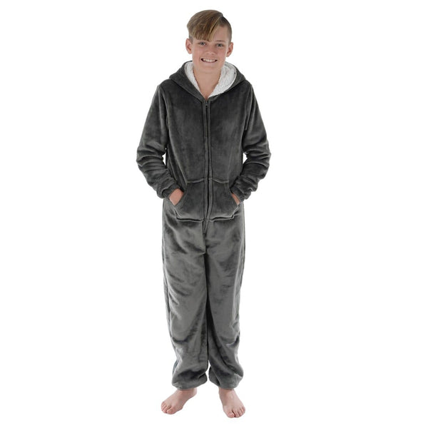 front view of boy wearing grey kids pyjama onesie with hands in pockets