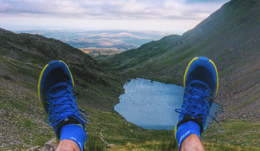 View of a lake and valley from runner wearing the Scarpa Spin running shoes