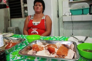 Manang Virgie serving the Lechon dinner