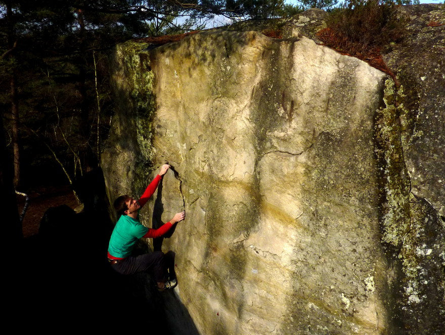 male boulderer on the circuits in fontainebleau