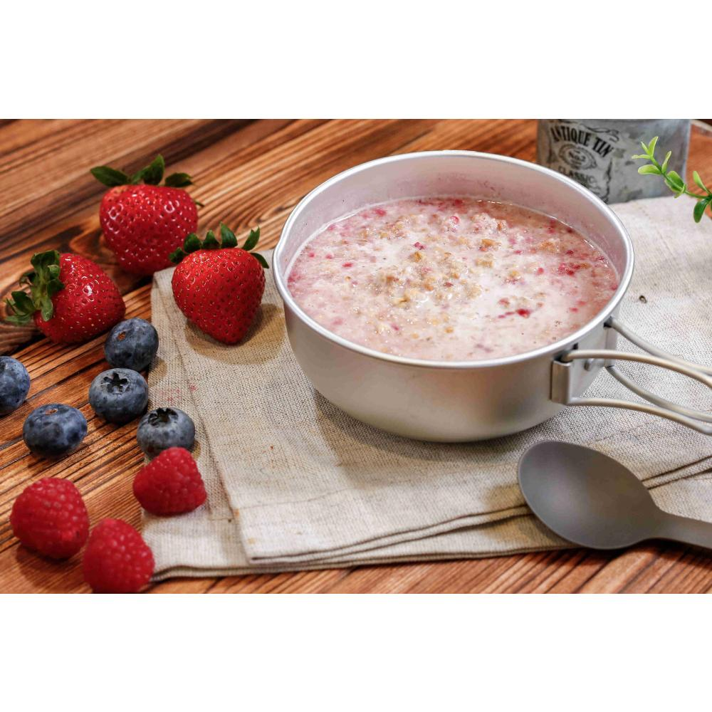 Expedition Foods Granola with Raspberries shown in bowl on a table with fresh ingredients