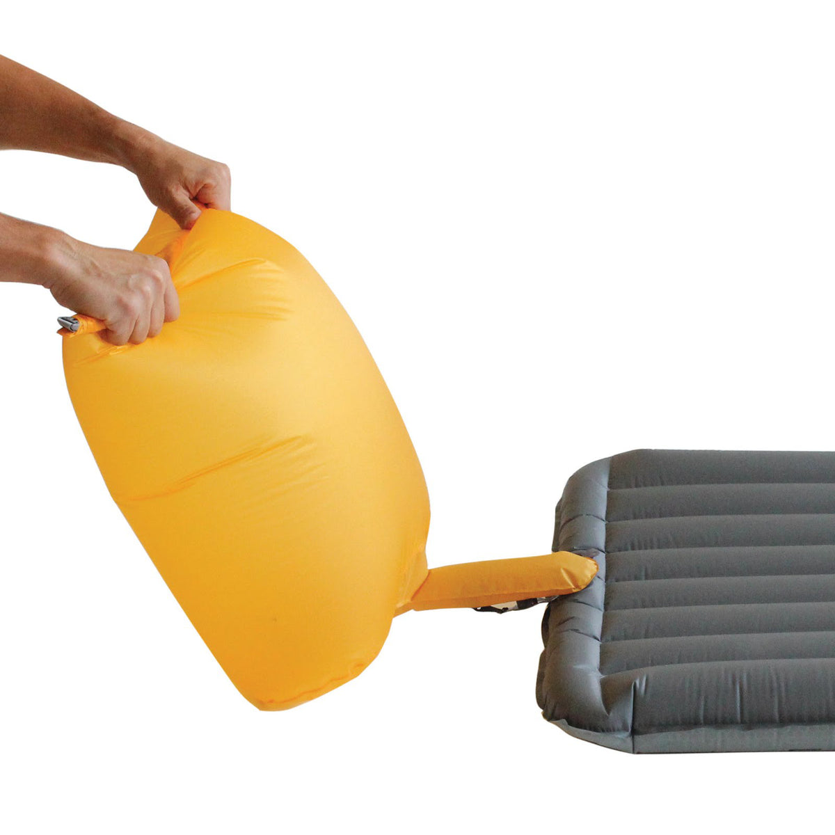 Exped DownMat UL Winter M sleeping mat shown being inflated with yellow pump sack