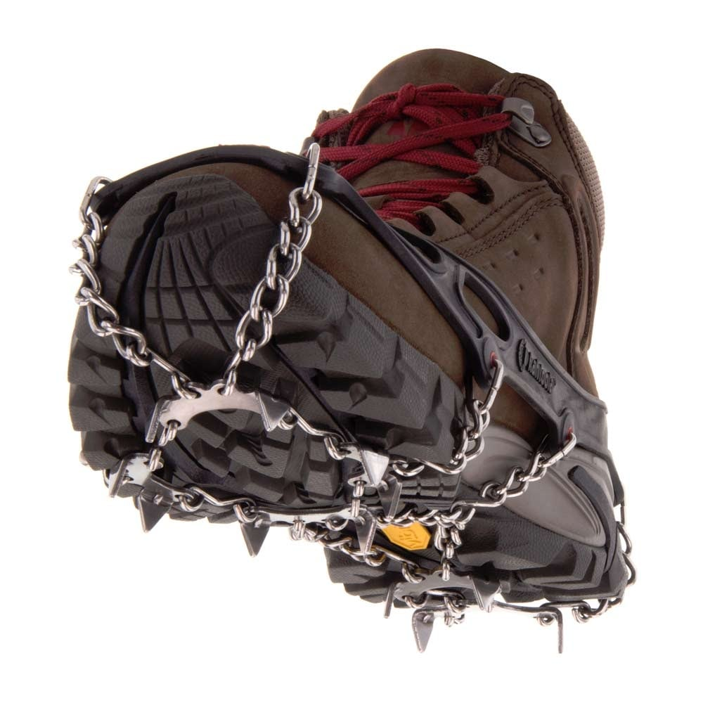 Kahtoola MICROspikes shown from the front on a brown walking boot