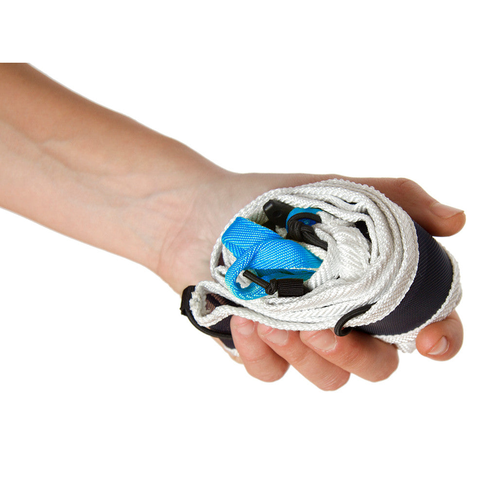 Blue Ice Choucas Light Harness, shown compact in the palm of a models hand