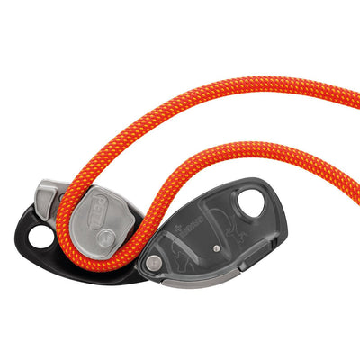 Petzl Grigri + belay device, showing open in use open with orange coloured rope