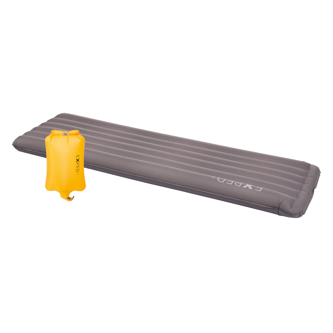 Exped DownMat UL Winter LW sleeping mat, shown laid flat in grey colour with yellow pump sack