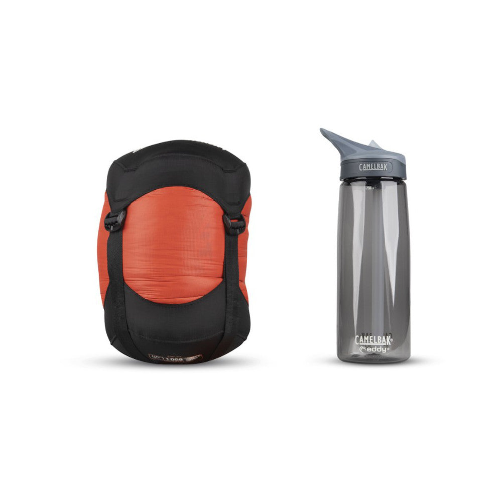 Sea to Summit Flame III Women's sleeping bag shown in stuff sack next to water bottle for size