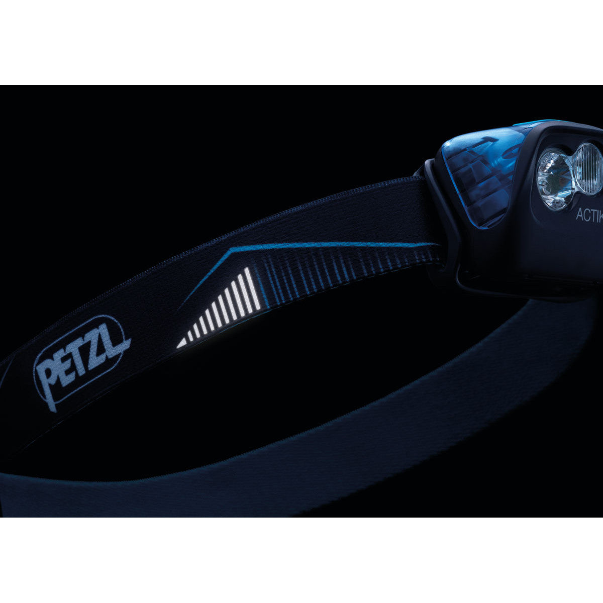Petzl Actik Headtorch in Blue showing artwork on blue strap that glows for night visibility