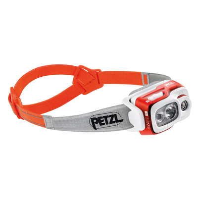 Petzl Swift RL Headtorch, front/side view in orange with orange and grey strap