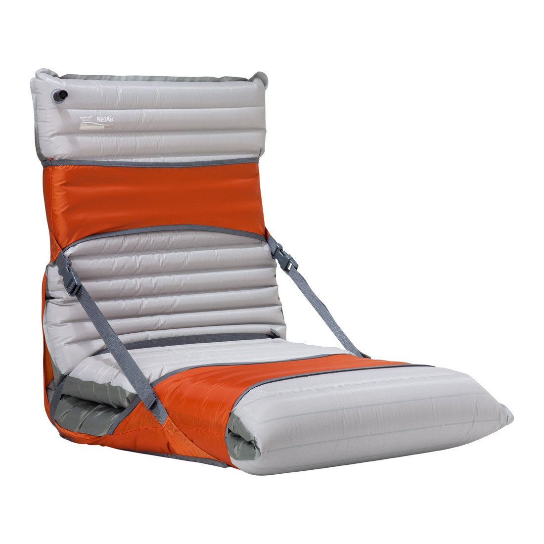 Thermarest Trekker Chair Kit 25, shown in use with a grey sleeping mat, kit in orange colour