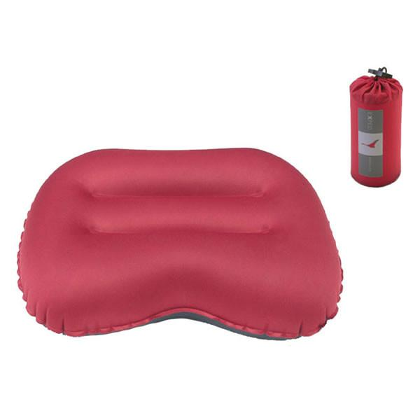 Exped Air Pillow M camping pillow, shown inflated next to stuff sack, in red colour