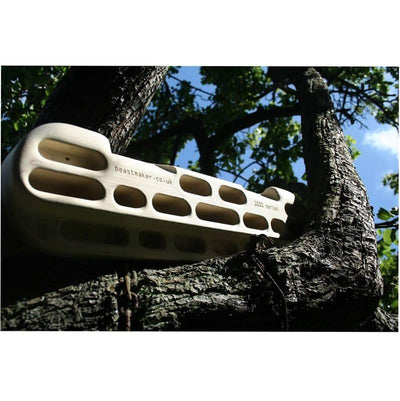 Beastmaker 1000 fingerboard shown hung on a tree