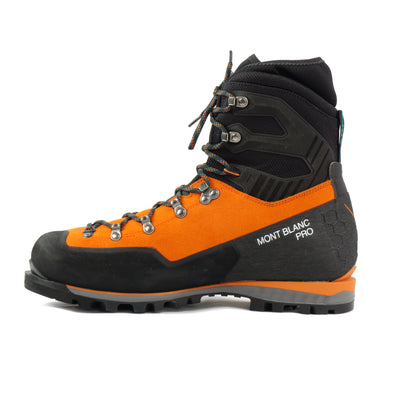 Side view of the Scarpa Mont Blanc Pro GTX with orange Perwanger outer and black rubber and flexible sock and Small Mont blanc pro written in white on the side of the shoe