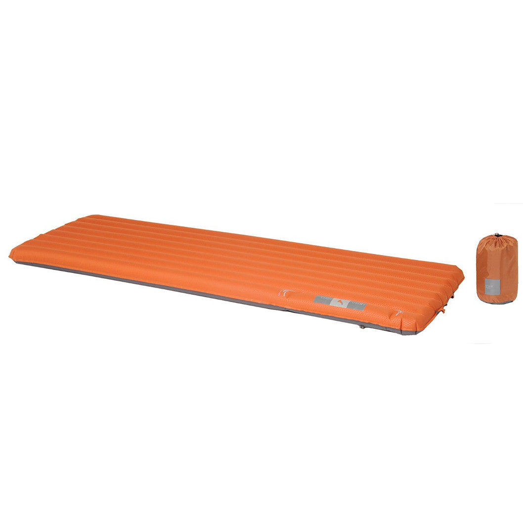 Exped SynMat 7 M sleeping mat shown laid flat in orange colour next to stuff sack