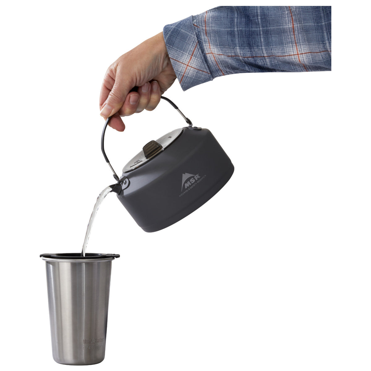 MSR Pika 1.0L Teapot shown in use pouring water into cup