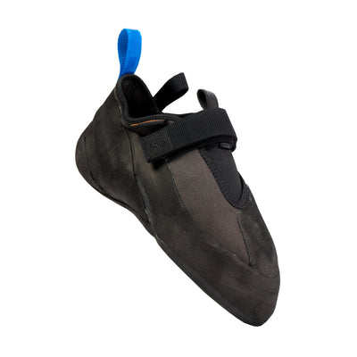 Tilted Unparallel Regulus climbing shoe showing the Large rubber toe patch and slipper construction