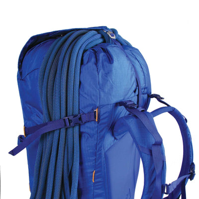 Blue Ice Warthog 45L rucksack, side view showing rope attached