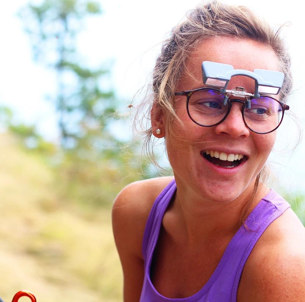 Y&Y Clip Up Belay Glasses, shown on female model