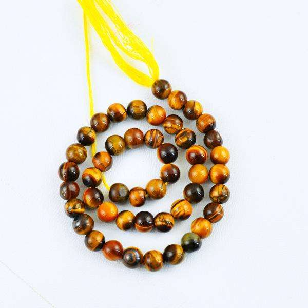 gemsmore:Genuine Round Shape Golden Tiger Eye Drilled Beads Strand