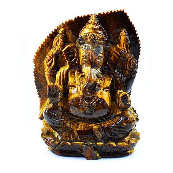 gemsmore:Hand Carved Golden Tiger Eye Ganesha With Leaf At Back