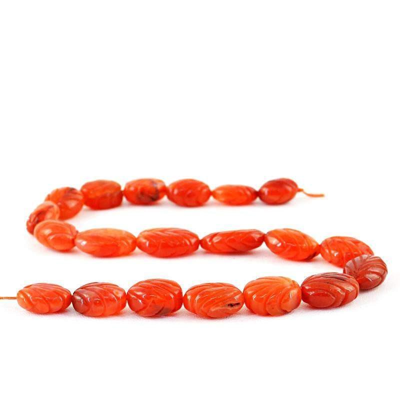 gemsmore:Natural Orange Carnelian Oval Carved Beads Strand